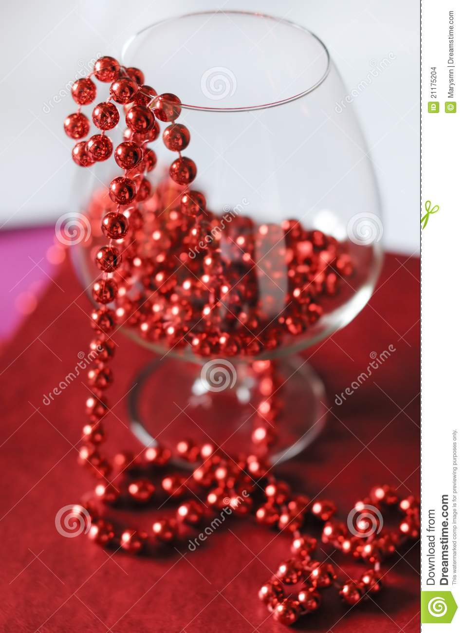 A goblet with red beads