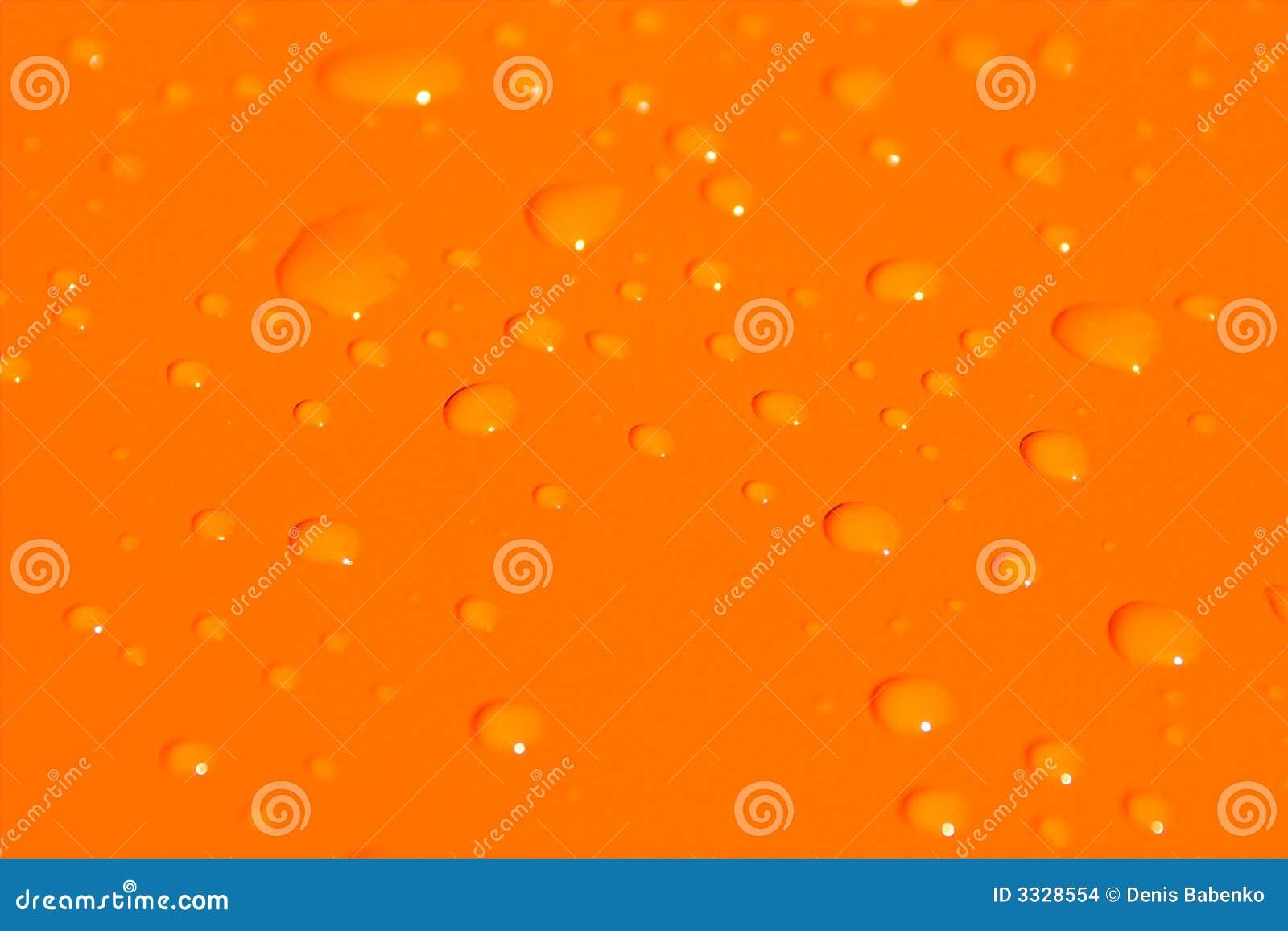 Gocce dell acqua sul Ba arancione del metallo