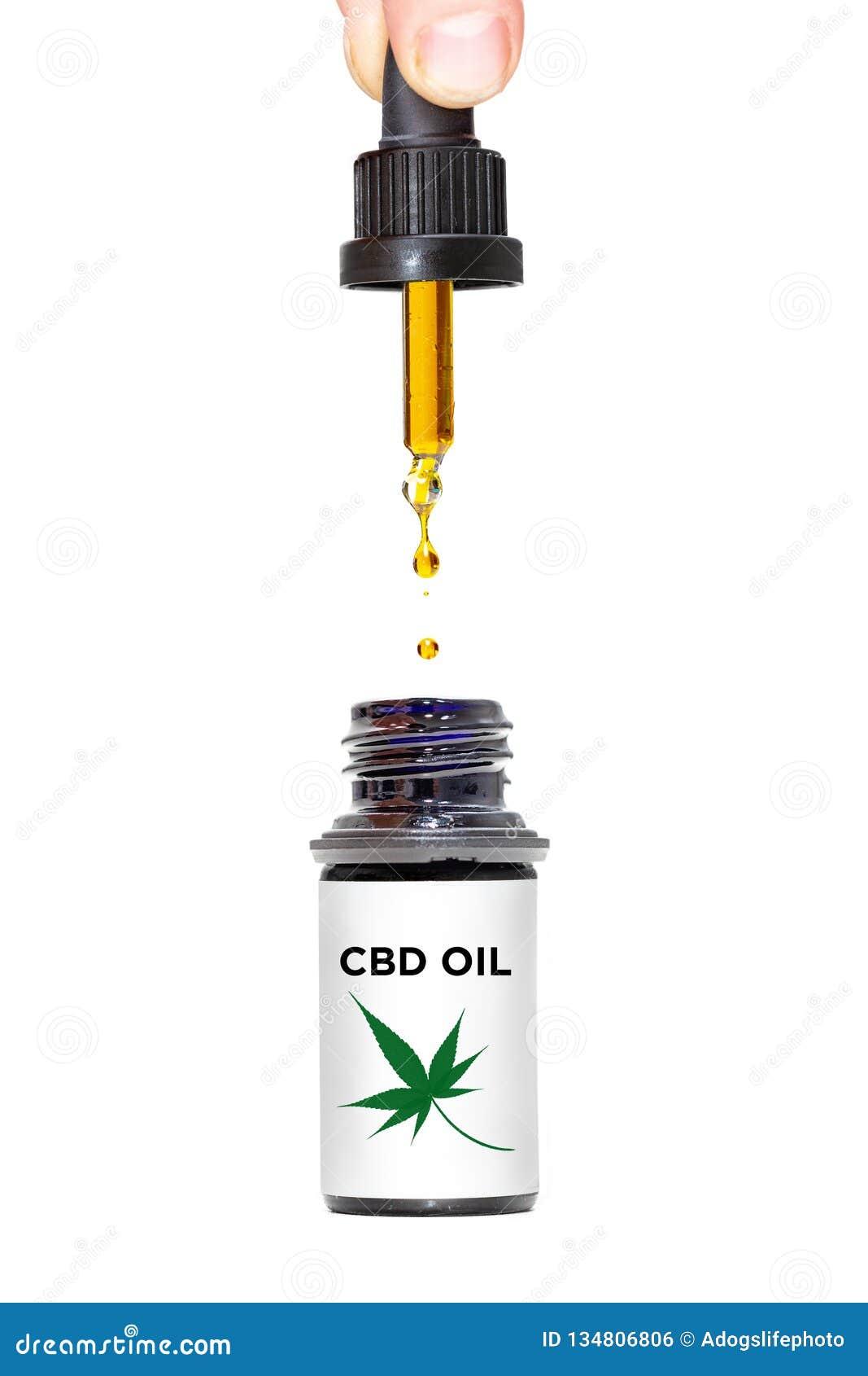 Gocce dell olio di CBD isolate su bianco