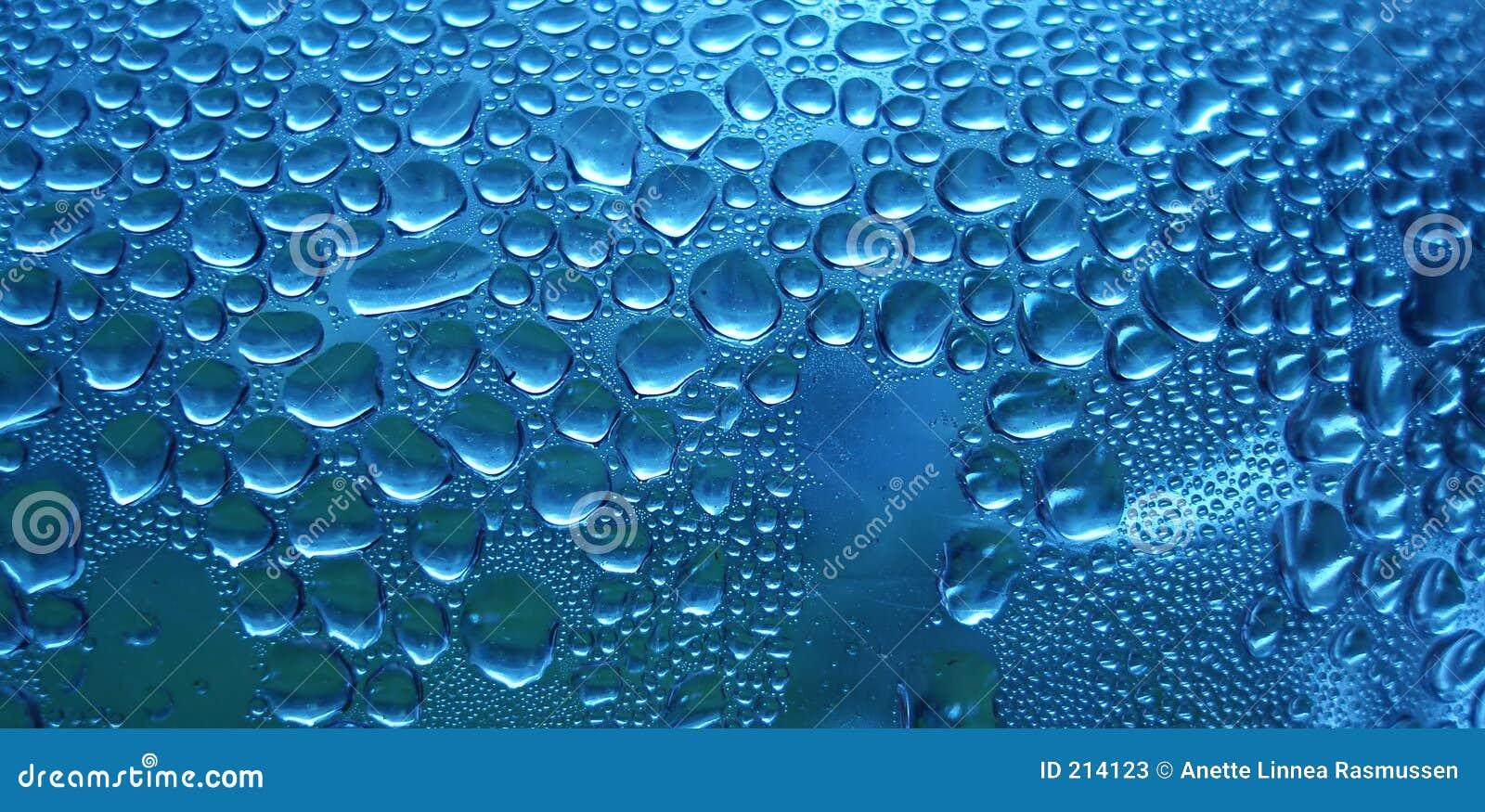 Download Gocce scintillanti blu immagine stock. Immagine di background - 214123