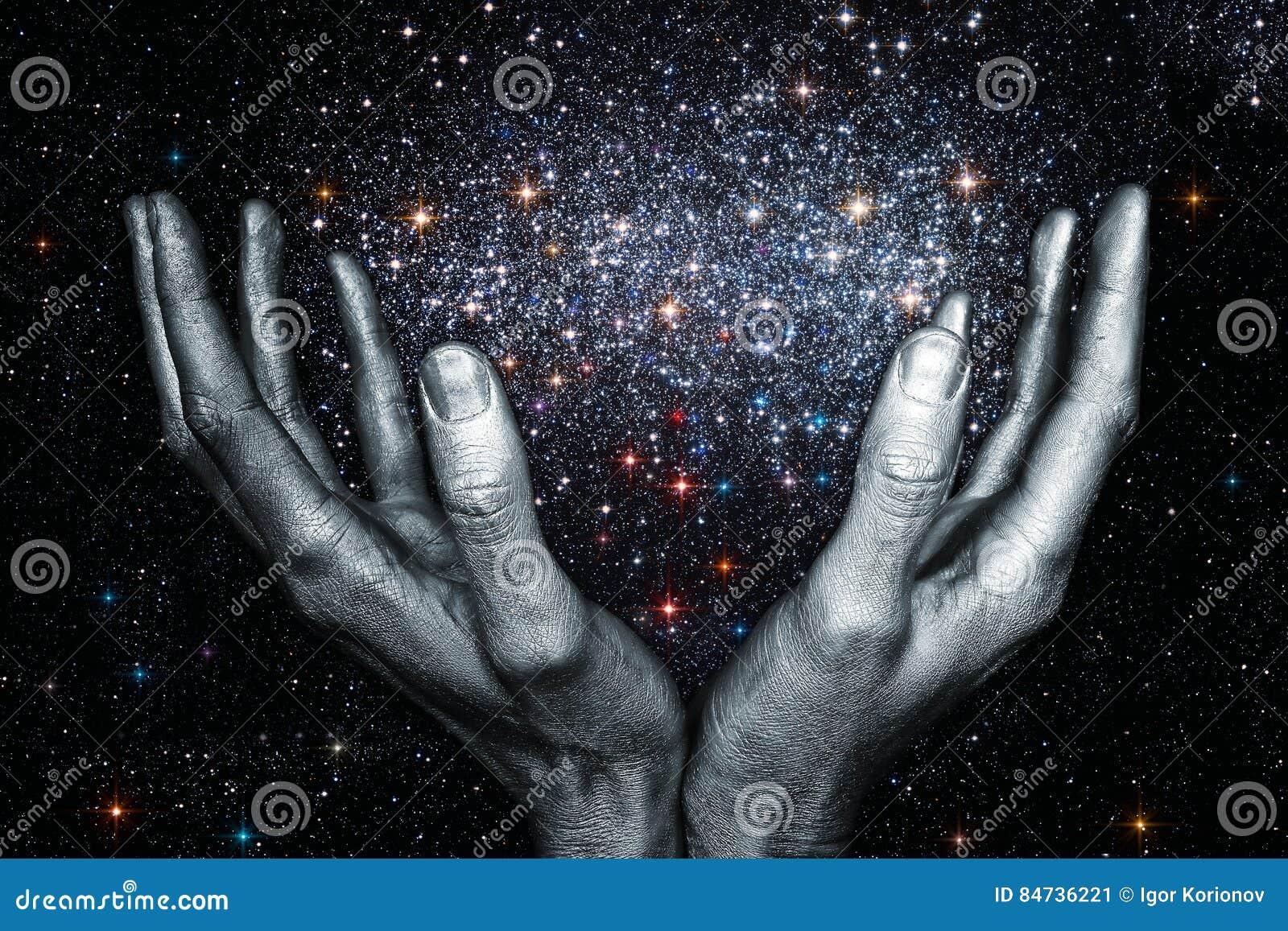 God hands holding a star galaxy