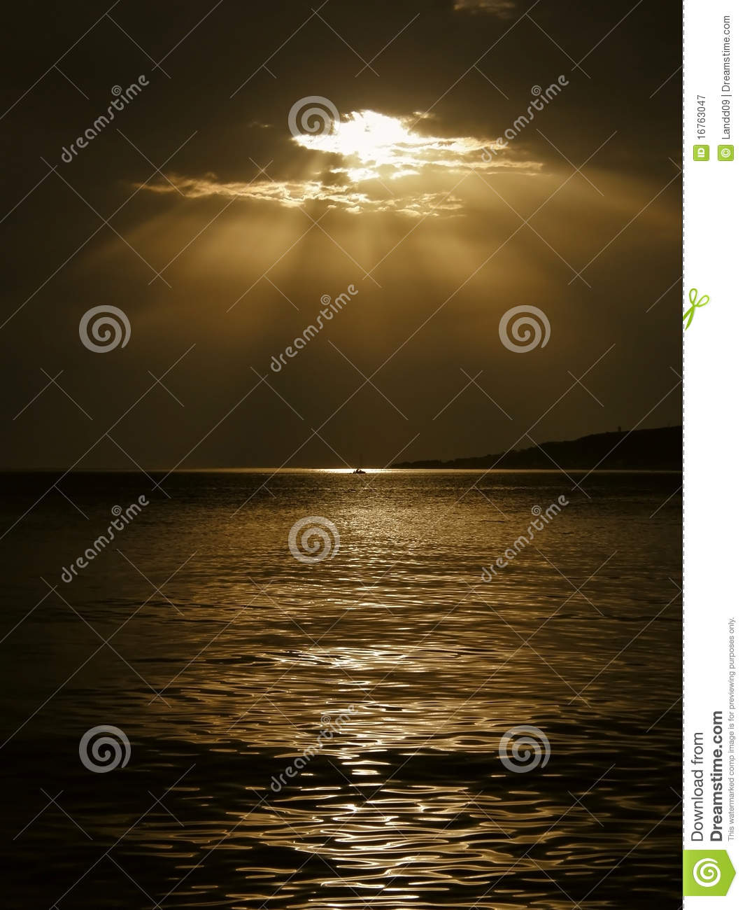 God s rays and a boat on the sea