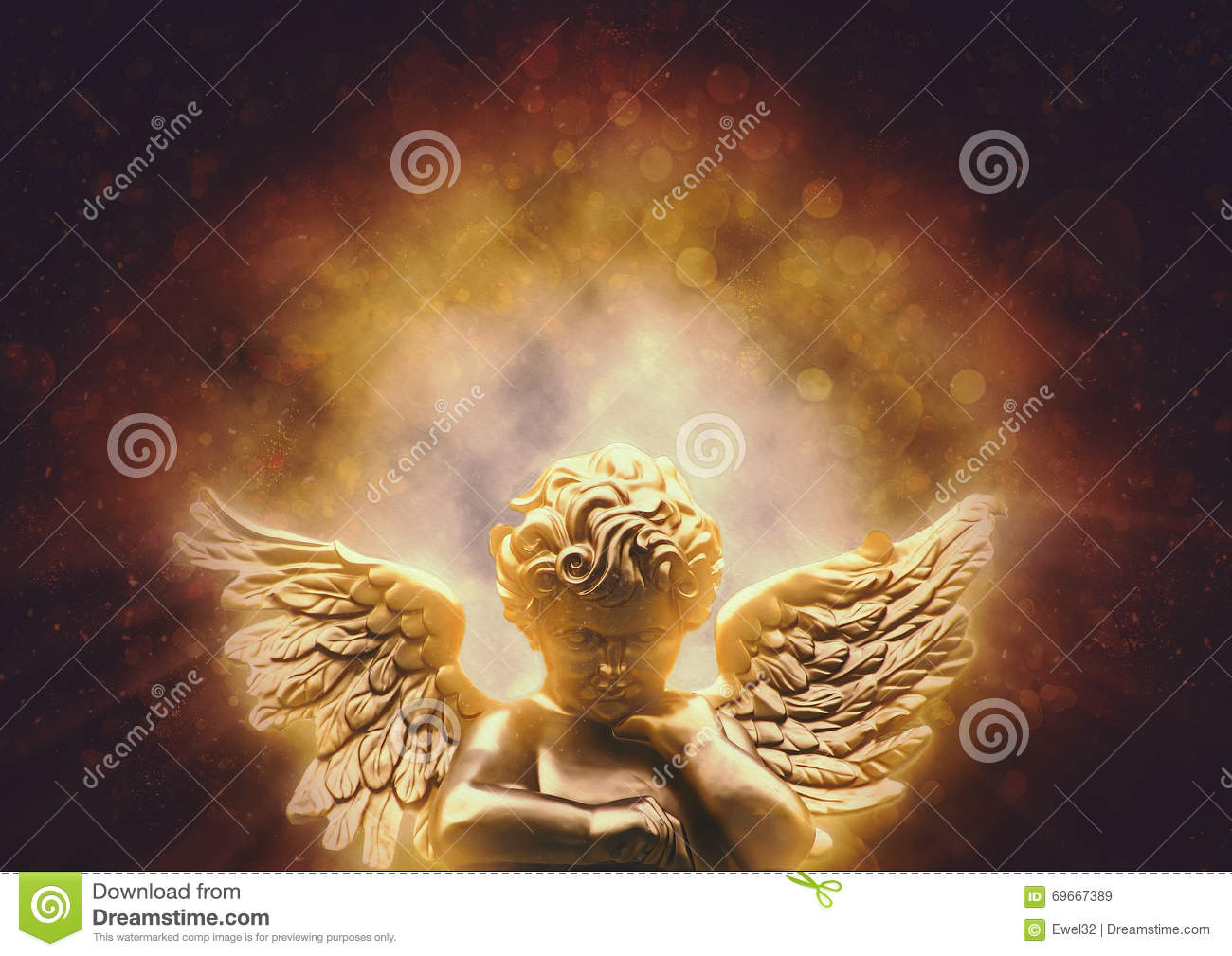 Gold angel with heavenly light touches.