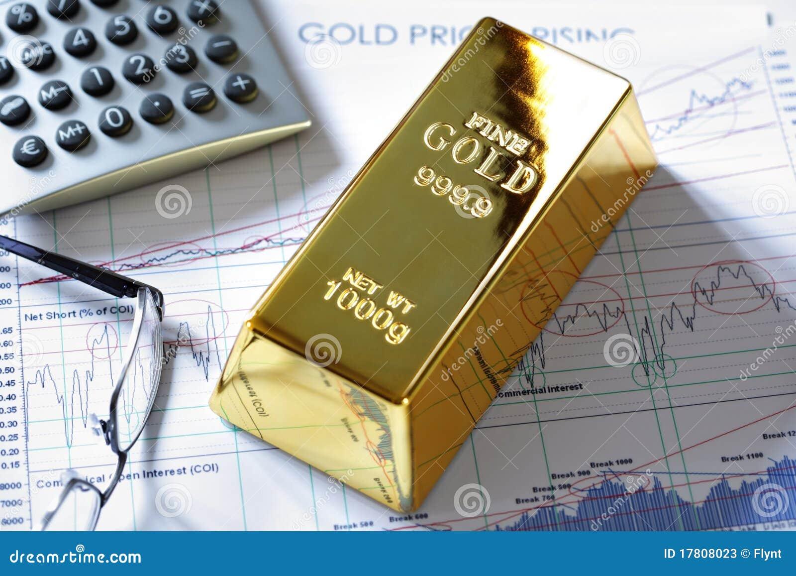gold bullion bar on a stocks and shares chart stock photos