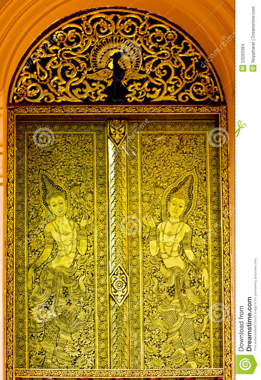 Gold carved ancient door of temple thailand stock photo