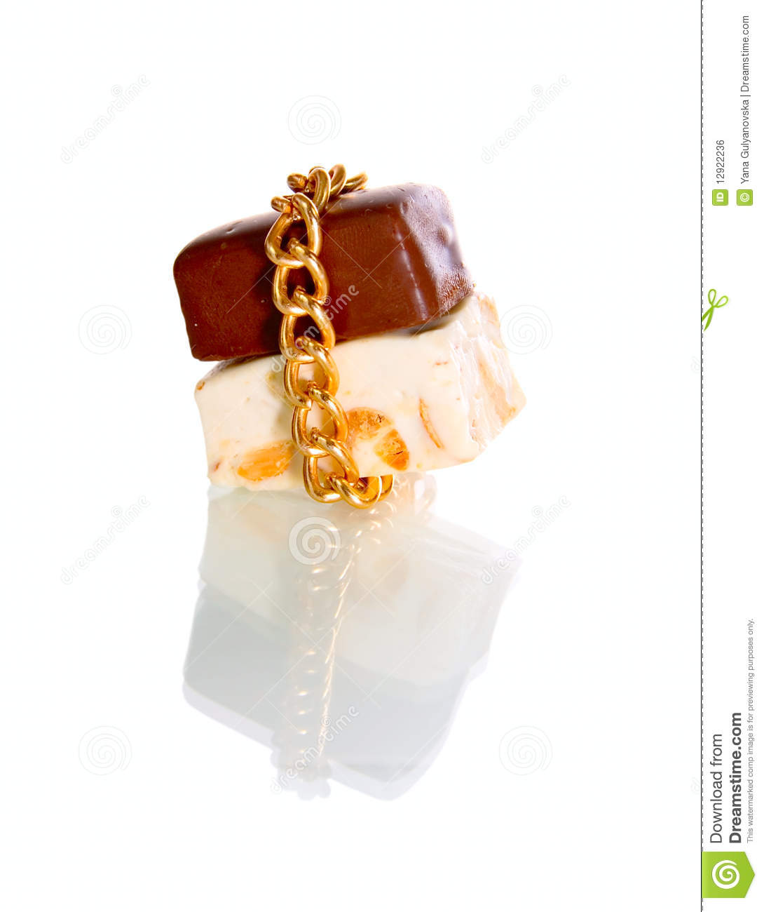 Gold Chain And Chocolate Candy Stock Photo - Image of golden