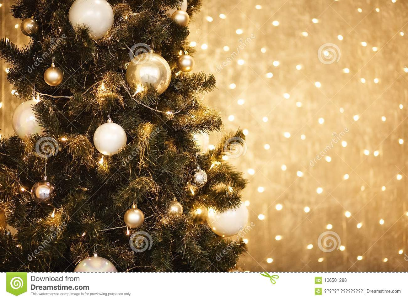 download gold christmas background of de focused lights with decorated tree 2018 stock photo