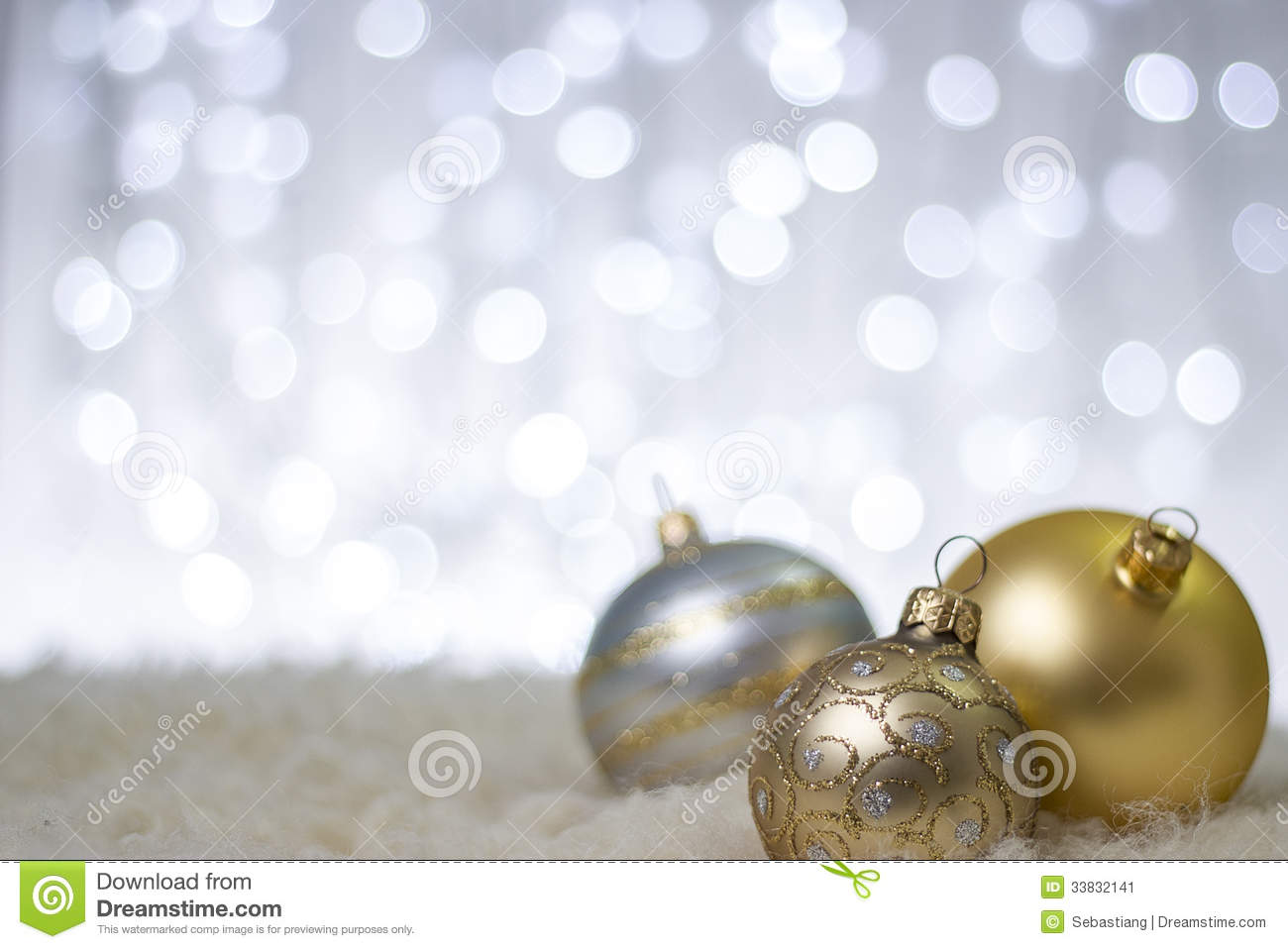 photography of gold and silver christmas balls in a winter scene beautiful christmas decorations close up image with gold silver christmas balls