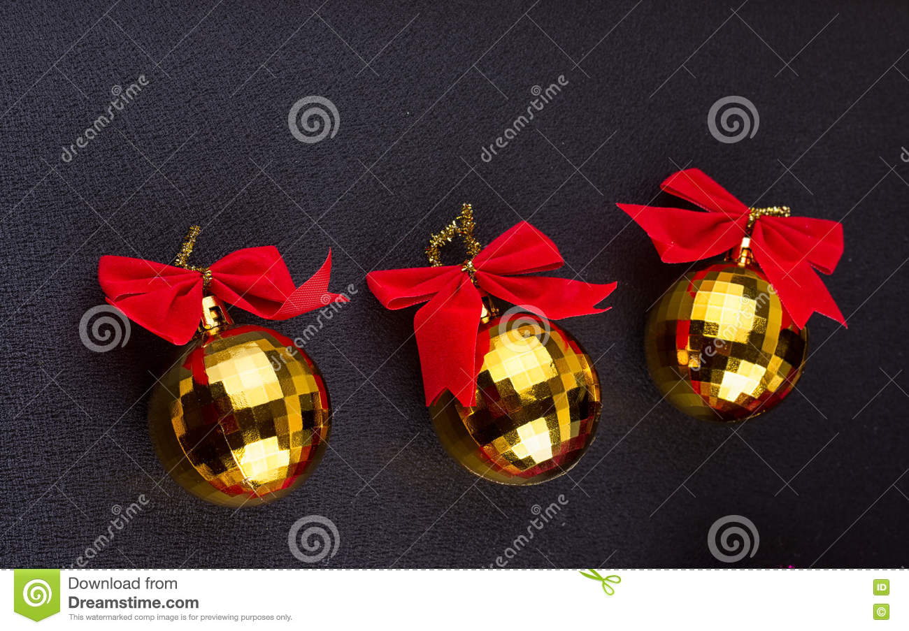 Gold Christmas balls with red ribbons