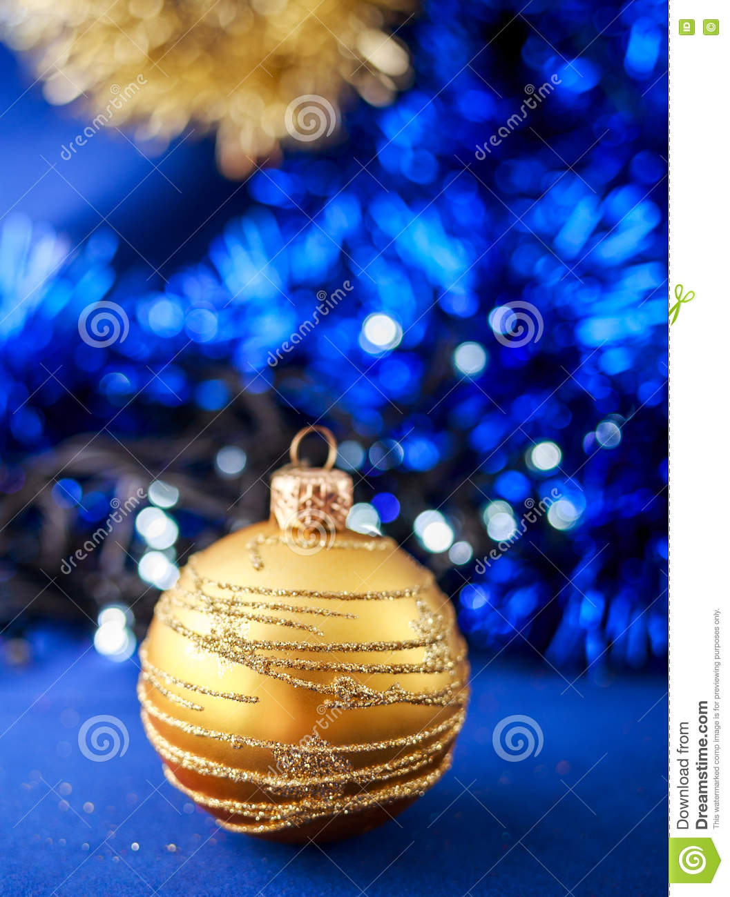 Gold Christmas Ornament On Blue Holiday Background
