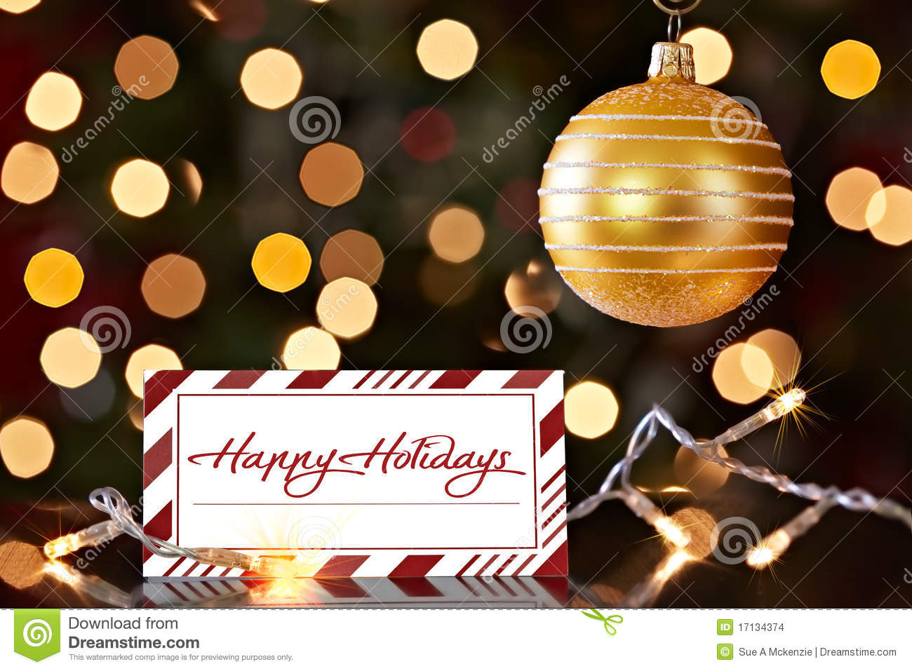 gold christmas ornament and happy holiday card stock images
