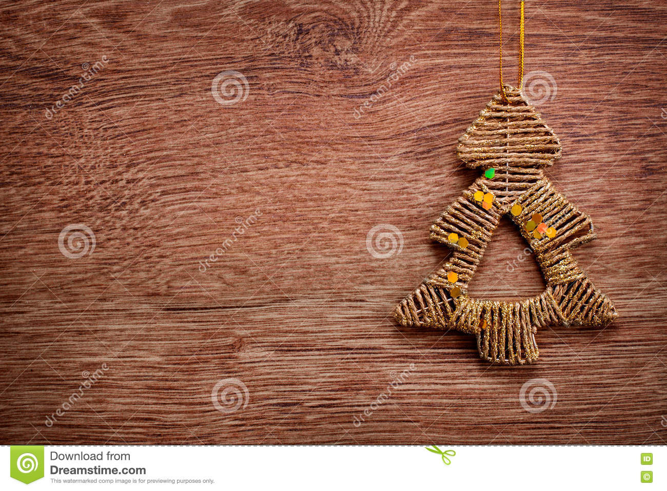 gold christmas ornaments on a rustic wooden background xmas card happy new year