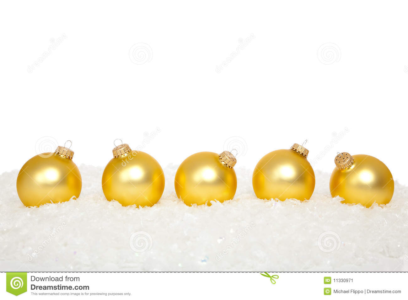 gold christmas ornaments in snow - Gold Christmas Ornaments
