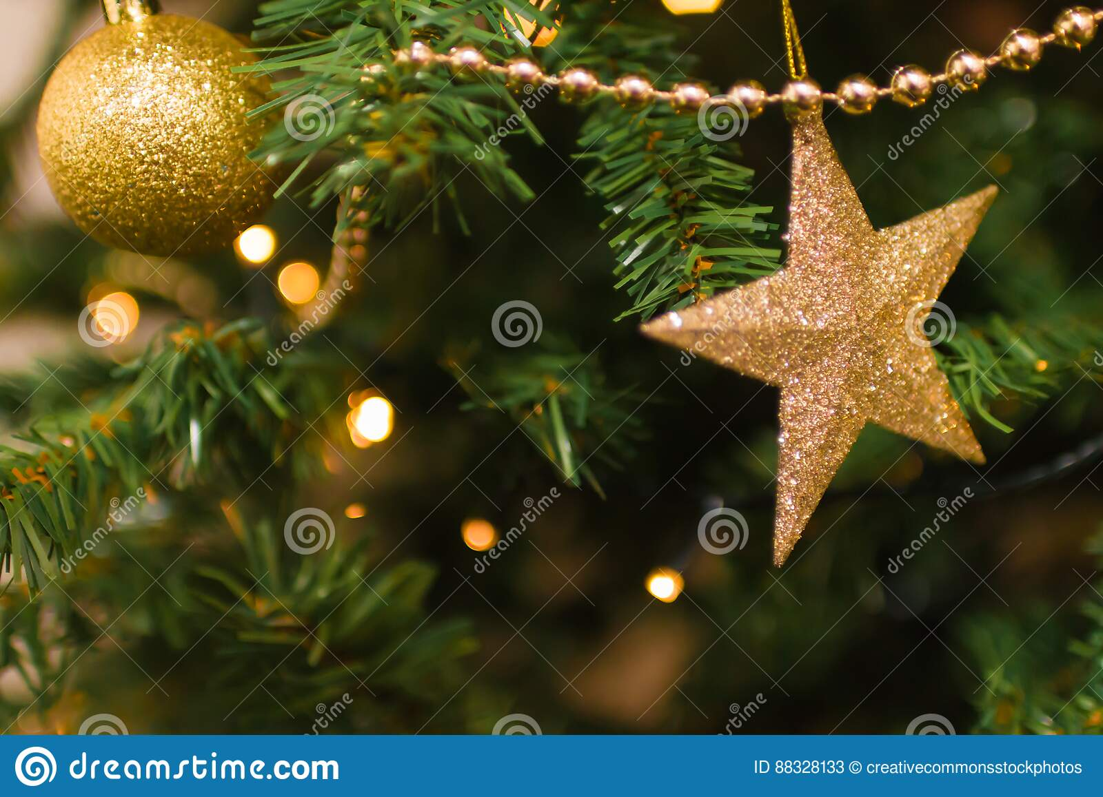 Gold Christmas Ornaments On Tree Picture Image 88328133