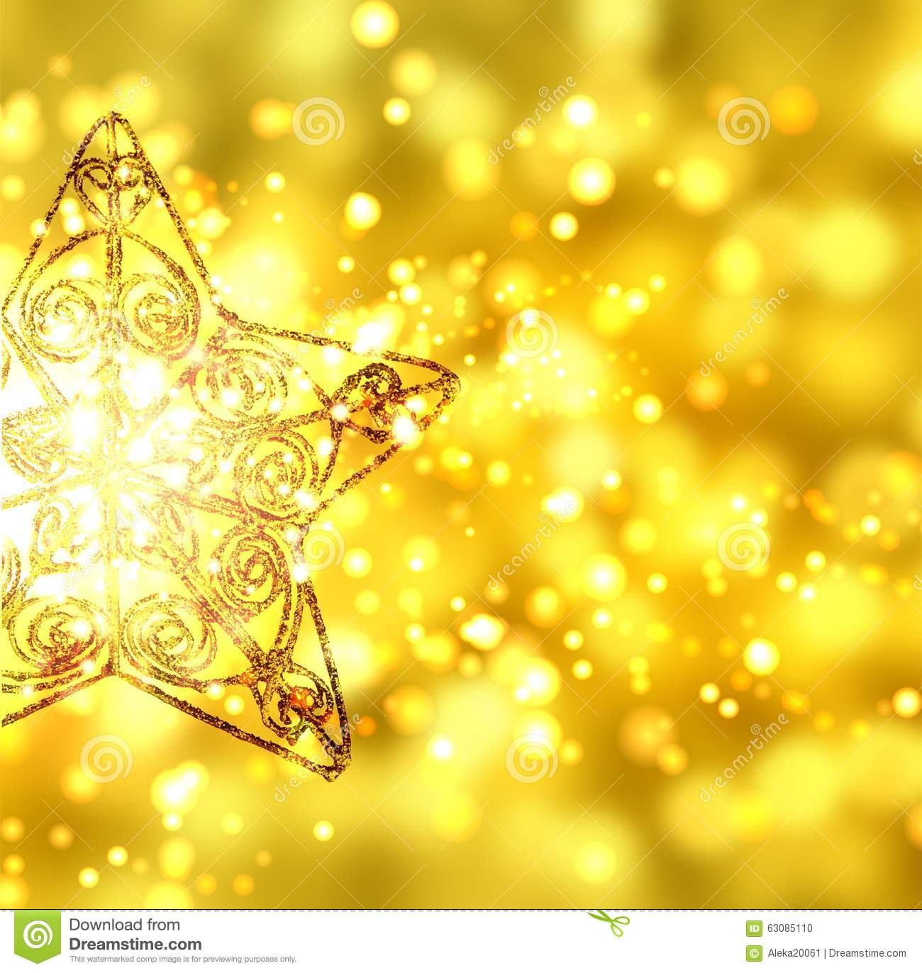 gold christmas star on gold background with sparks stock