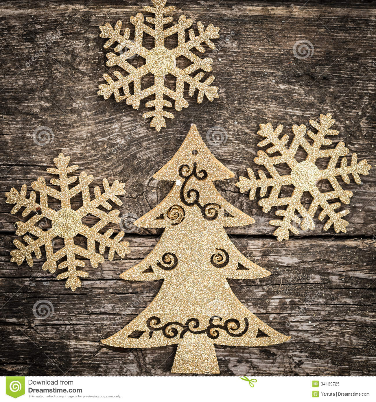Christmas tree decorations gold - Gold Christmas Tree Decorations On Grunge Wood Royalty Free Stock Photo