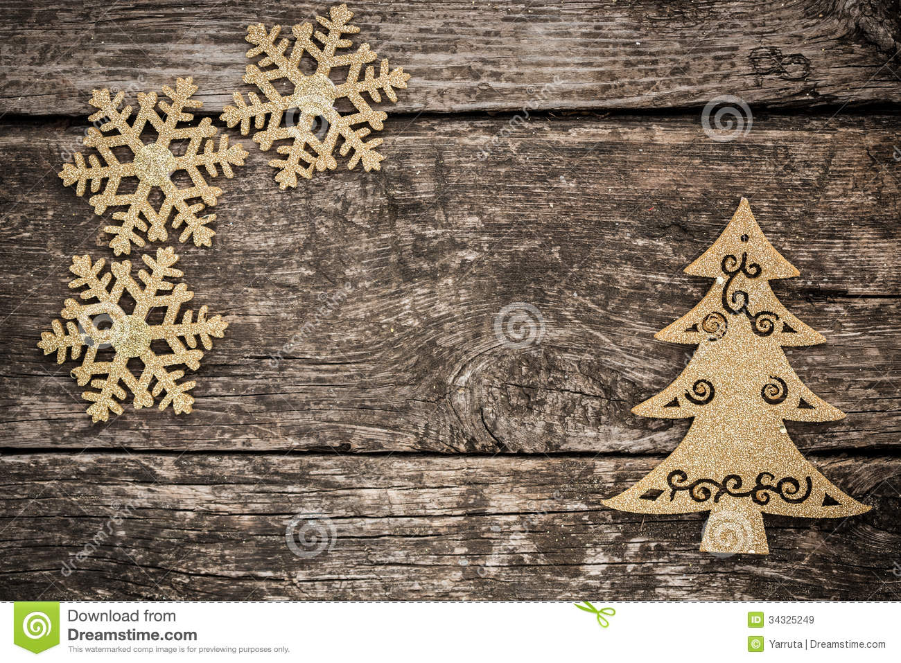 Christmas tree decorations gold - Gold Christmas Tree Decorations On Grunge Wood Royalty Free Stock Images