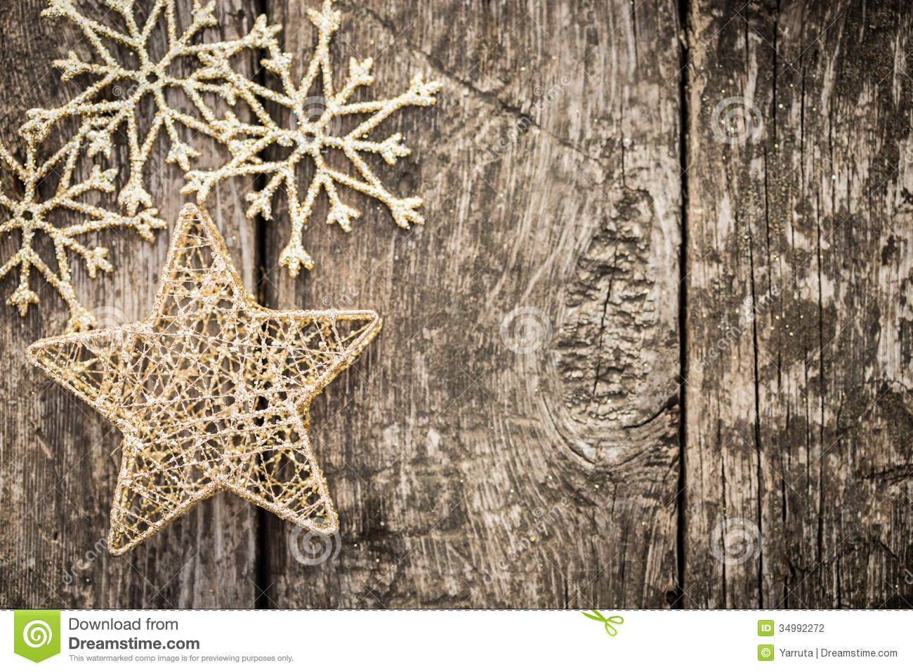 Gold christmas tree decorations on grunge wood stock for Back ground decoration