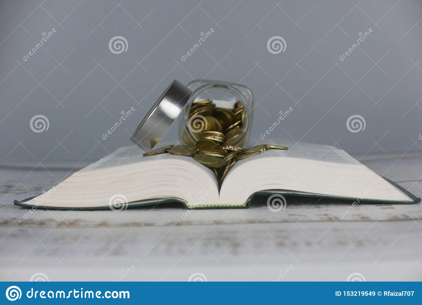 Gold coins on book. Finance and education concept