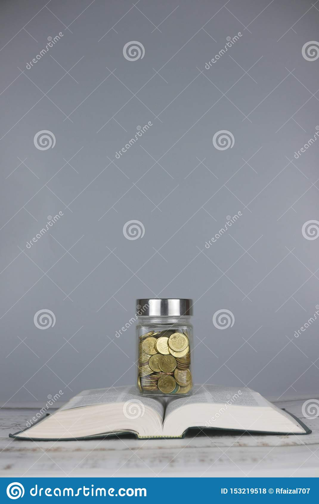 Gold coins on book. Finance and education concept. Copy space for text or logo