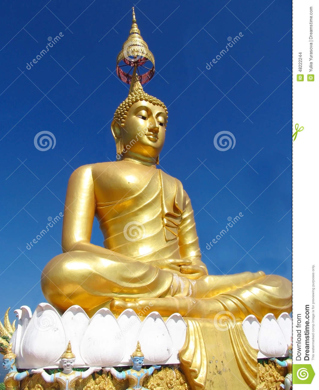 Gold colour Buddha statue in Buddhist temple