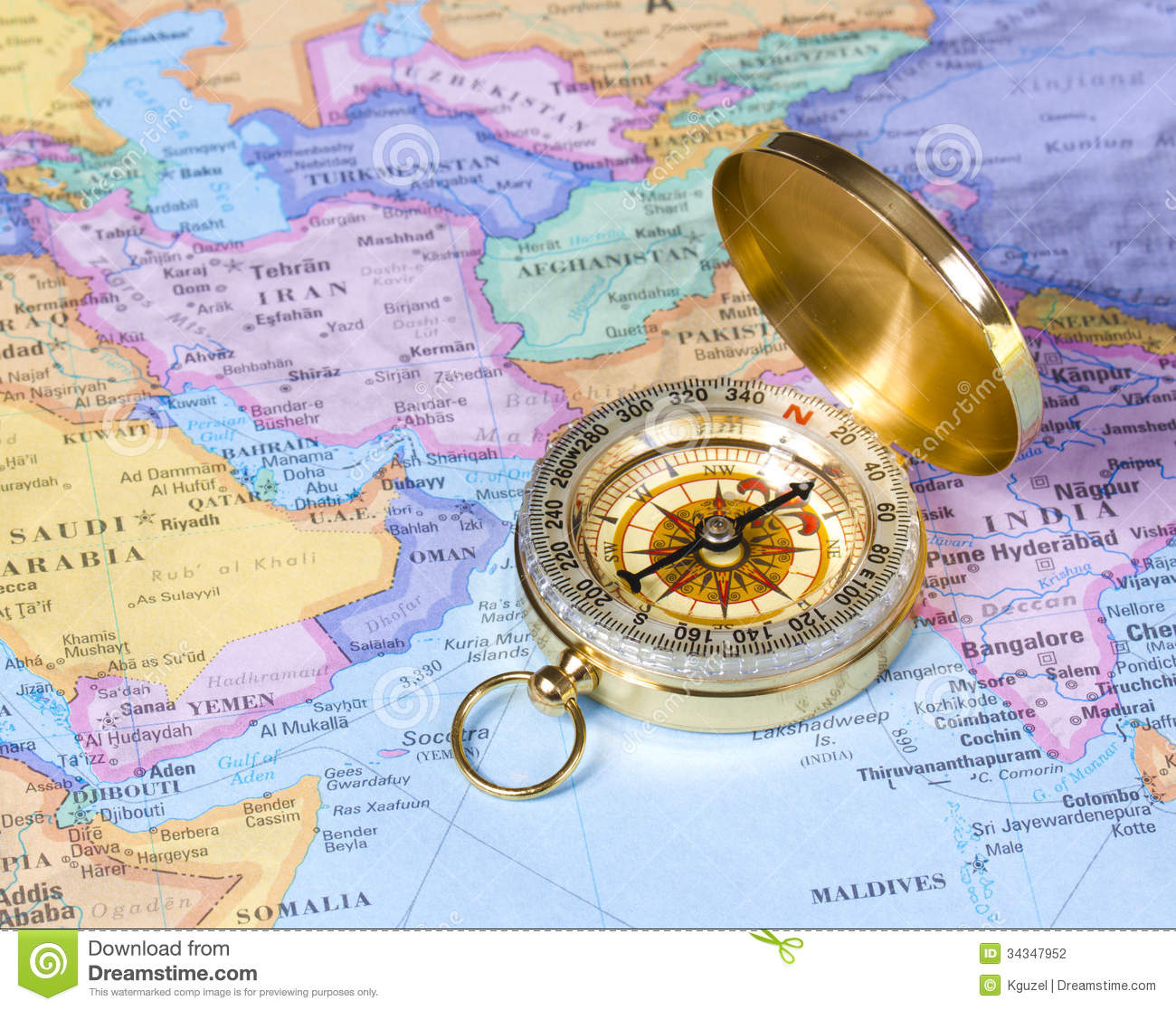 Gold compass on map of Asia