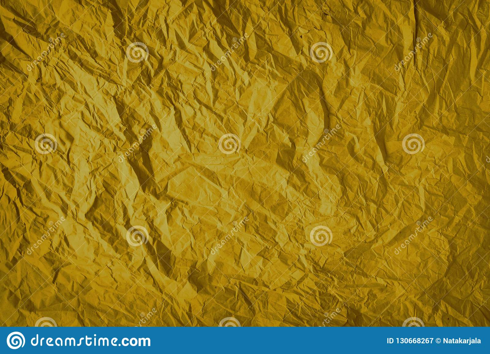 Gold crumpled wrapping paper background, texture of grey wrinkled of old vintage paper, creases on the surface of gray paper.