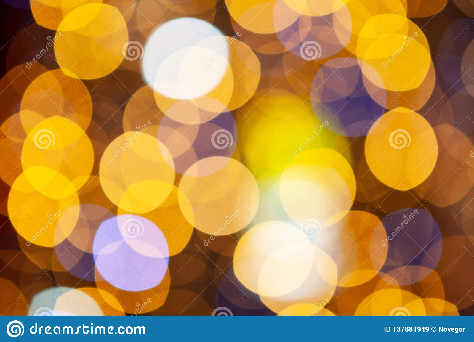 Gold glittering christmas lights. Blurred abstract background, close-up