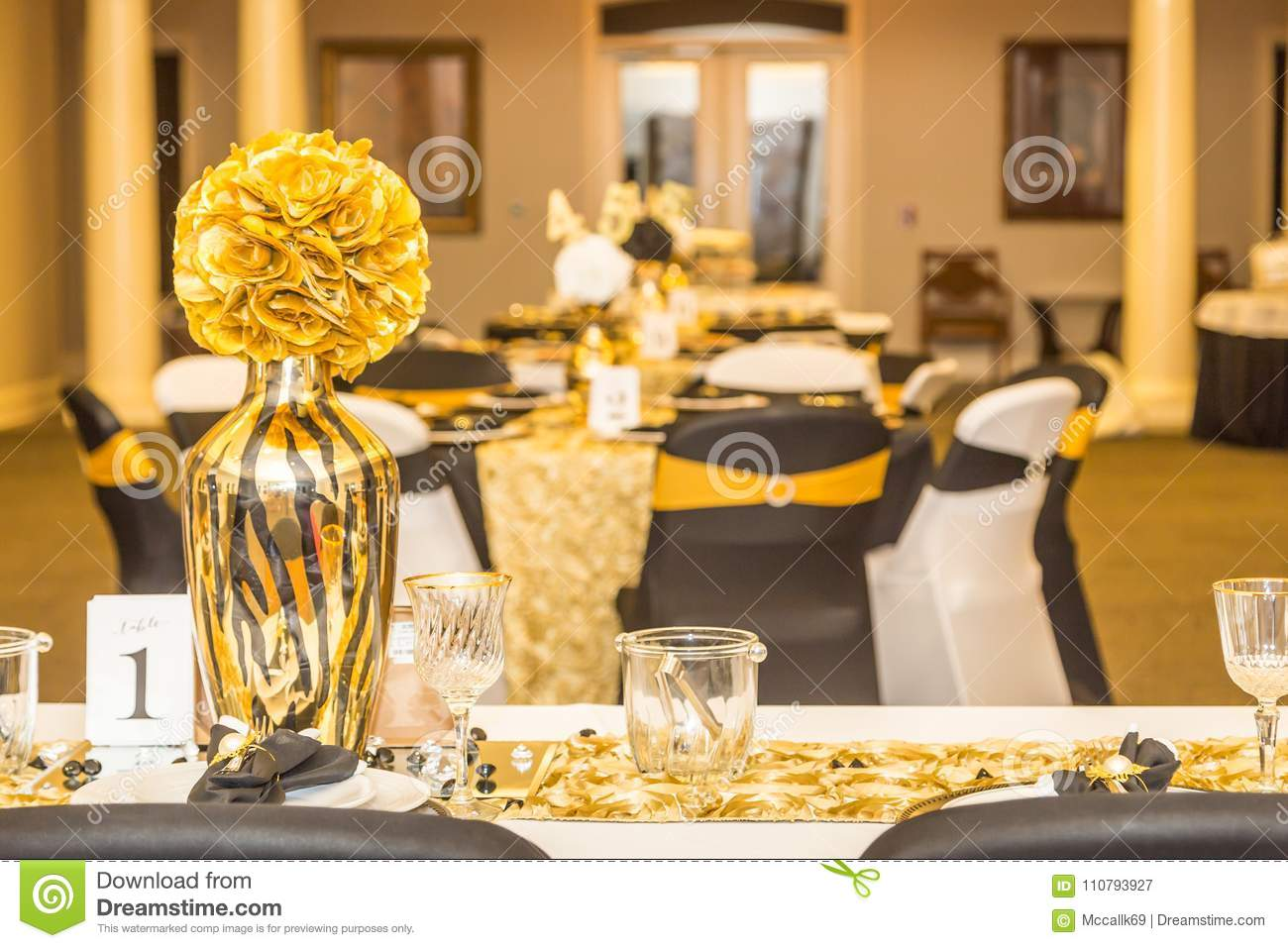 Gold Head Table Center Piece And Event Decor Or Presentation At A Birthday Party With Black White As Theme Colors