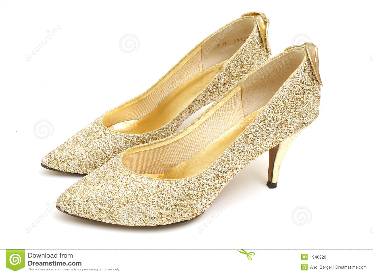 Stock Photo: Gold High Heel Shoes