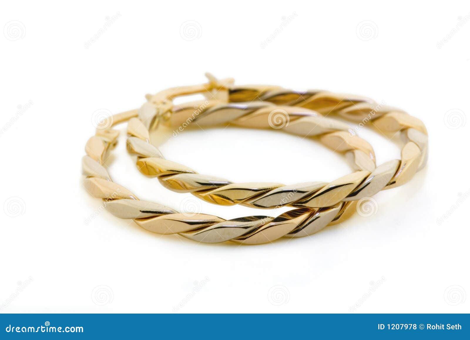 Gold Jewellery - Earrings stock photo. Image of girl, gift - 1207978
