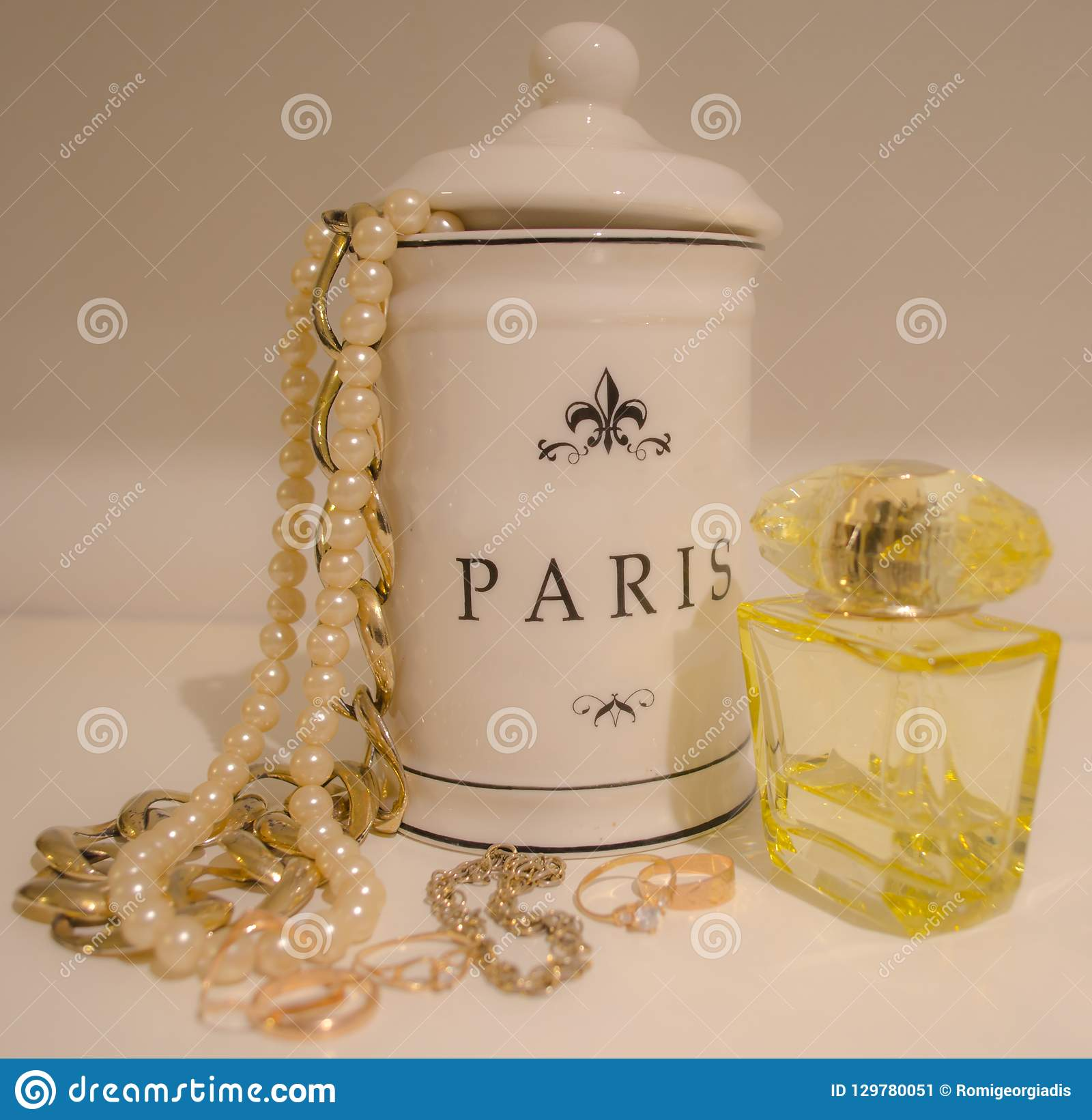 Gold jewelry and perfume for woman