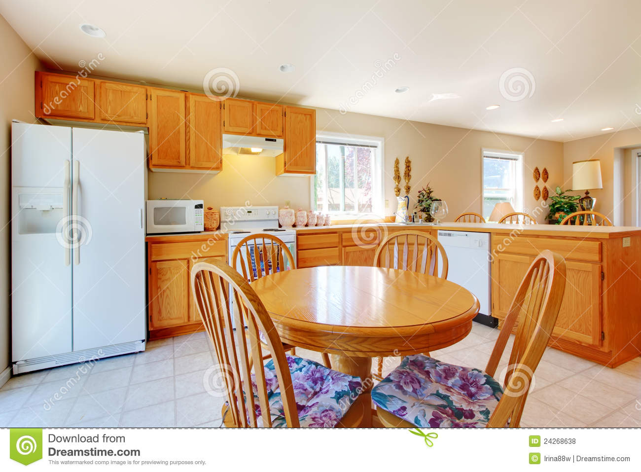Gold Kitchen With White Antique Cabinets Royalty Free