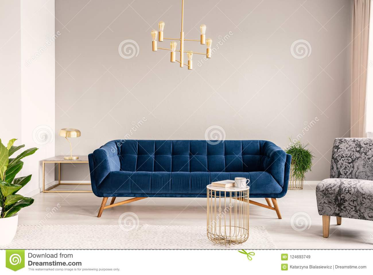 Gold Lamp Hanging Above Royal Blue Sofa In Real Photo Of Light Grey Sitting Room Interior With Empty Wall Stock Image Image Of Armchair Apartment 124693749