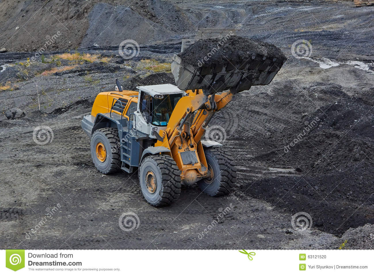 Gold mining in Susuman. An auto-loader with a full ladle