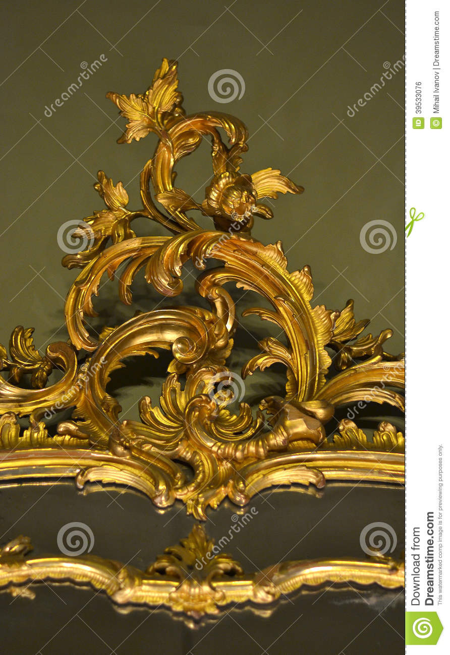 Gold ornament with leaf and nature elements