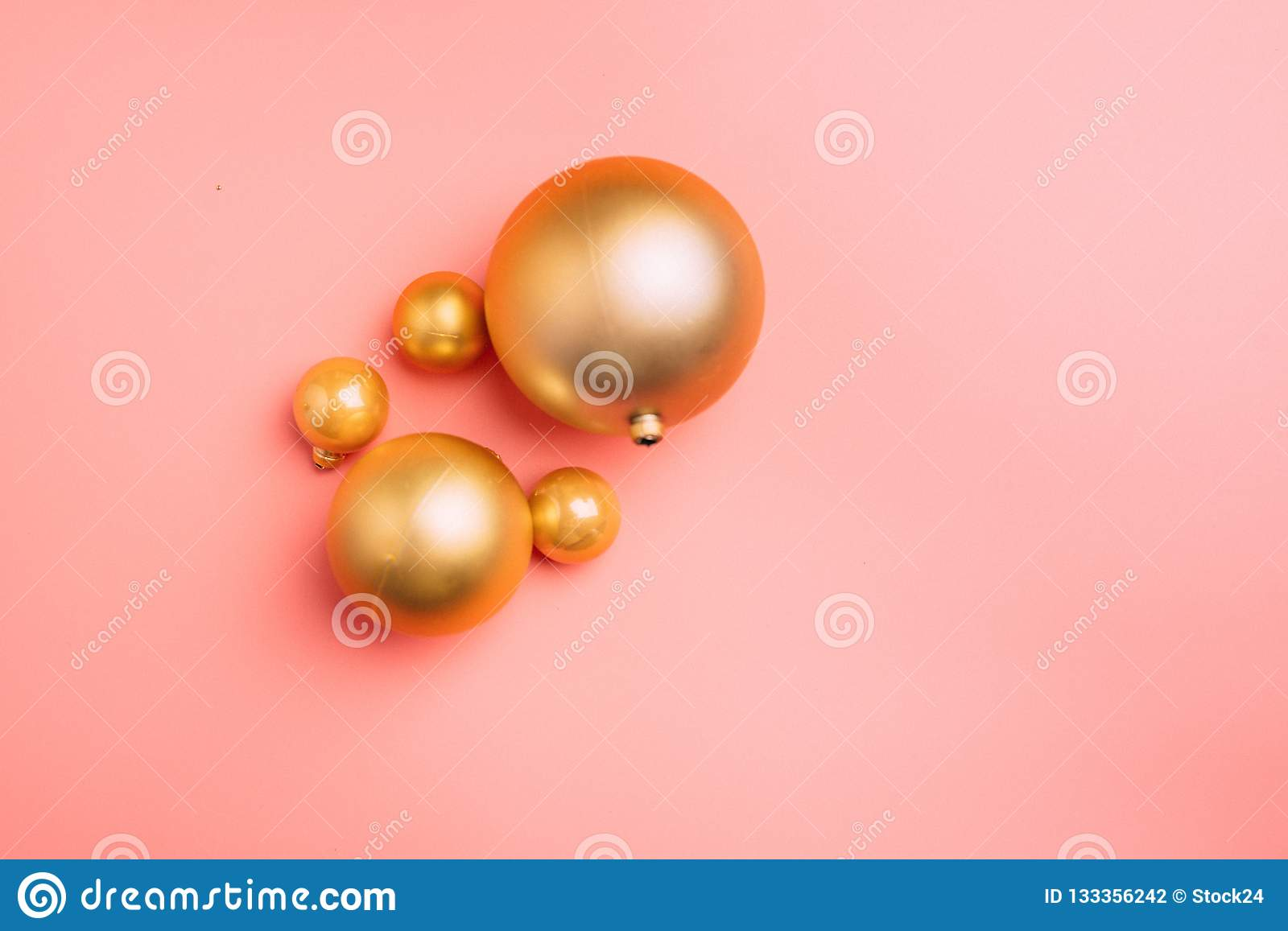 Gold and pink Christmas balls on wite background. Flat lay, top view copy space