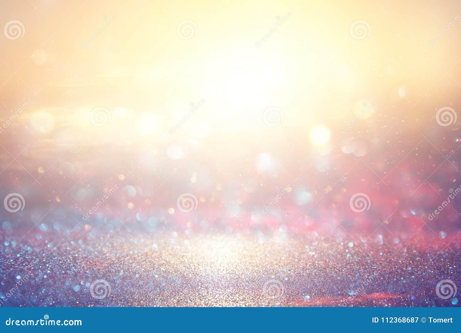 gold and pink glitter lights background. defocused.