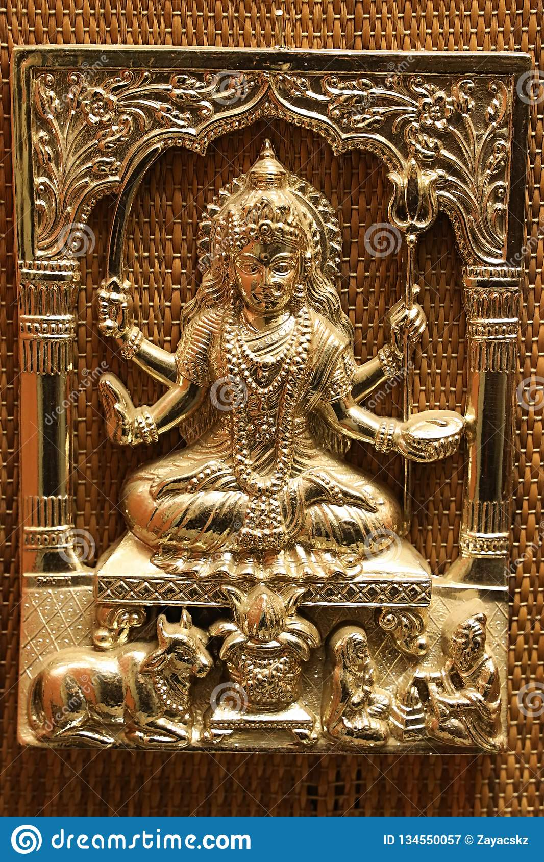 Gold plated steel embossed anaglyph picture of hinduistic god Shiva with trident called trishula and sword