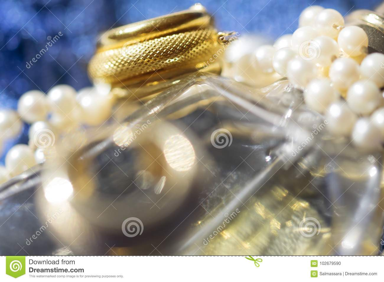 Gold ring and pearl necklace