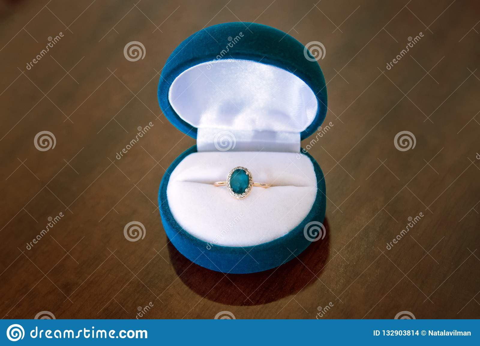 Gold ring with topaz in box