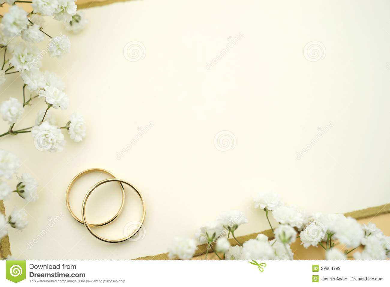 Gold rings with empty card and flowers.
