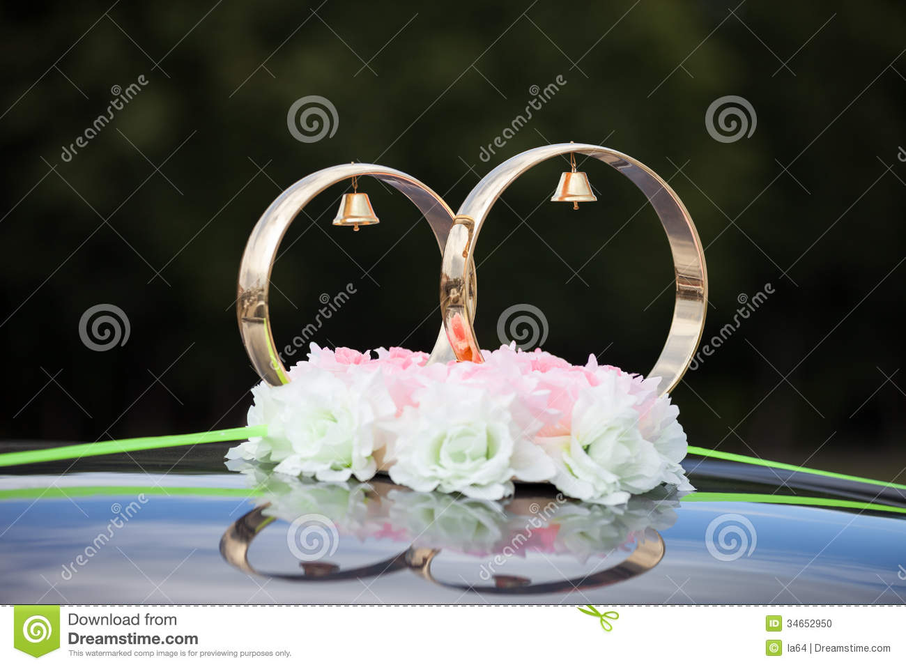 Gold rings and rose flowers on wedding car stock photo image 34652950 - Just married decorations for car ...