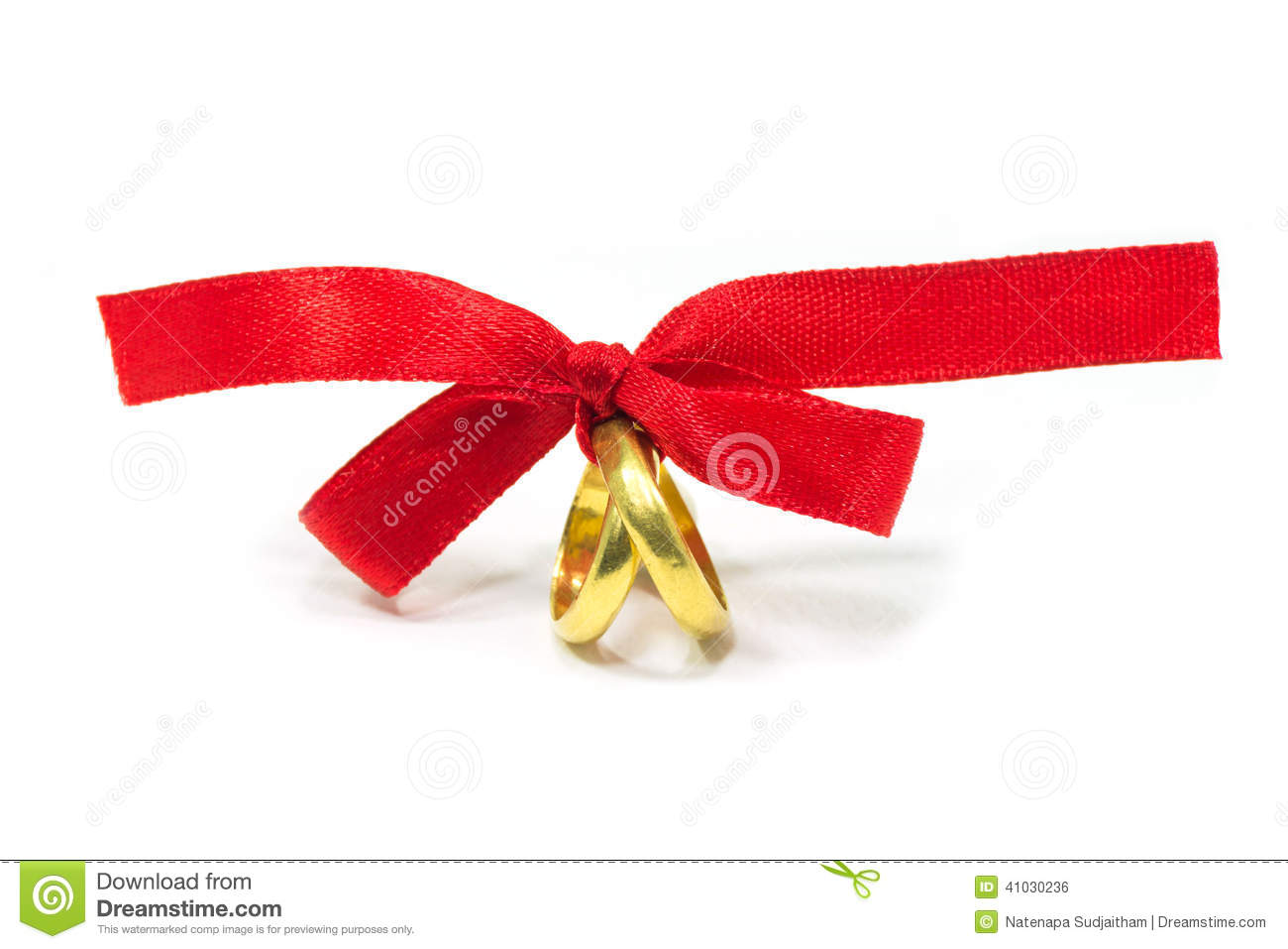 Gold rings tied with red ribbon