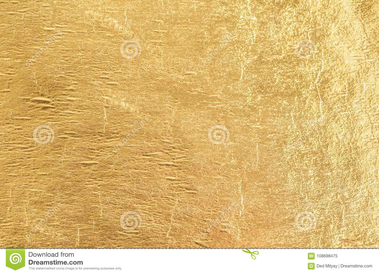 Gold shiny foil background, yellow gloss metallic texture