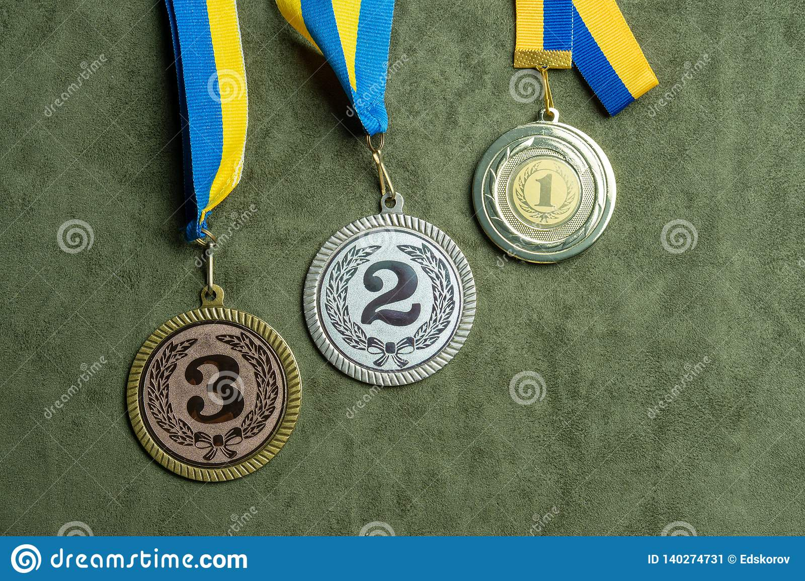 Gold, silver or bronze medal with yellow and blue ribbons