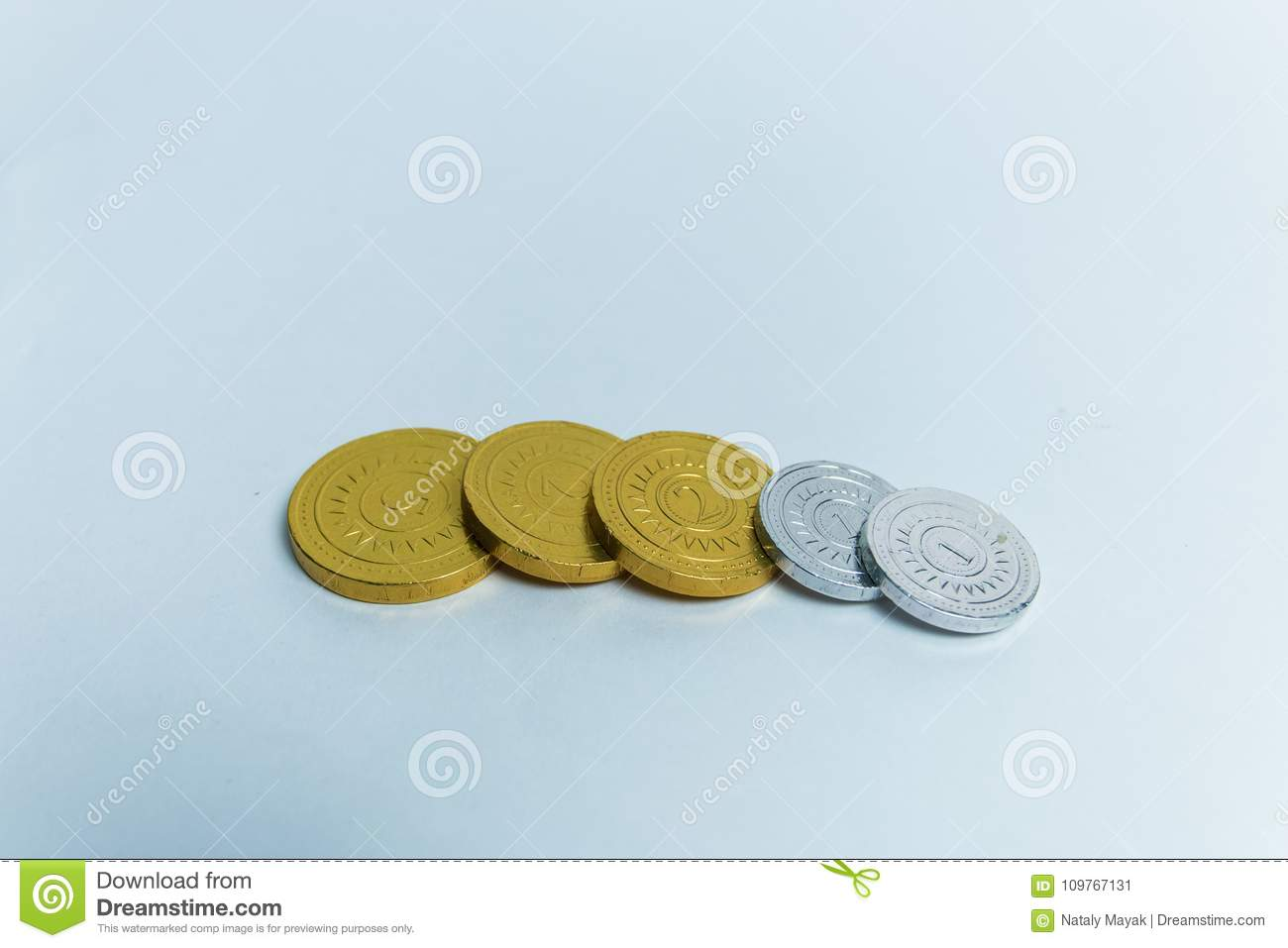 Gold and silver chocolate coins in wrappers