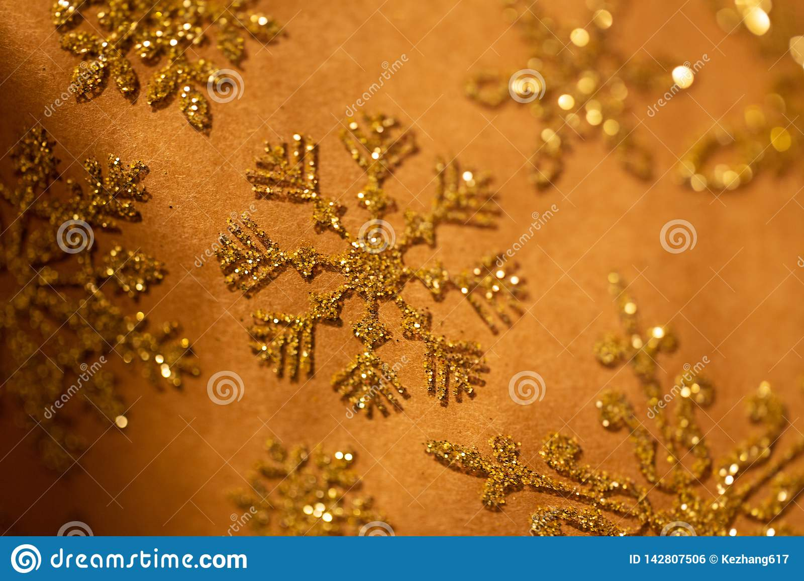 Gold snowflake glitter pattern on brown