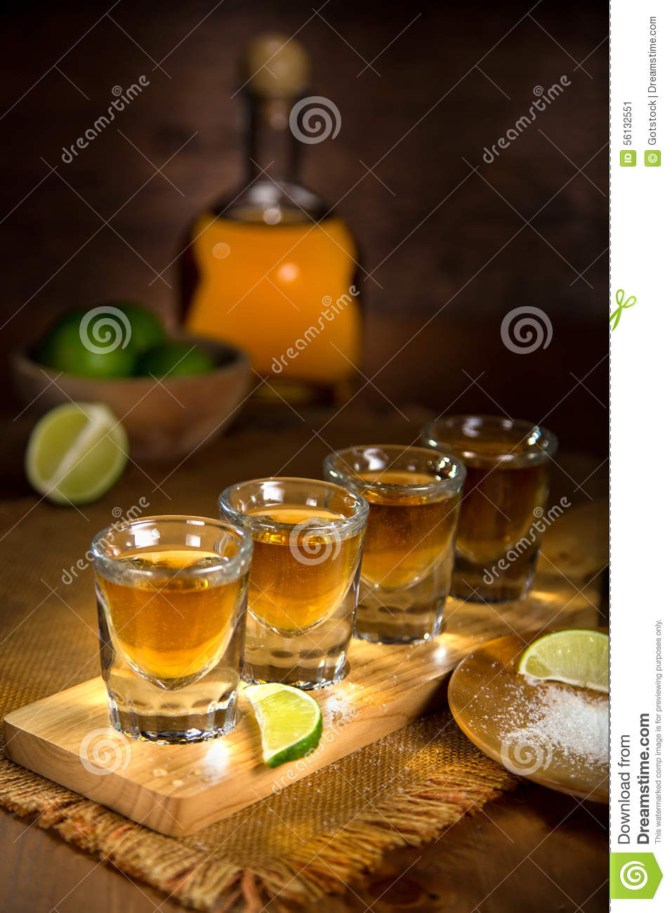 artistic lighting. Gold Tequila Shot Glasses And Bottle Served In A Group Artistic Lighting Stock Image - Of Group, Drink: 56132551