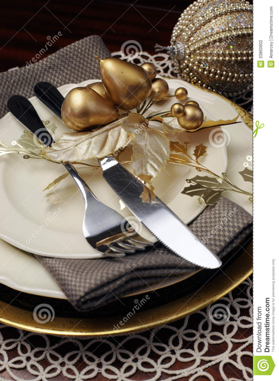 Gold Theme Christmas Dinner Table Setting Close Up On